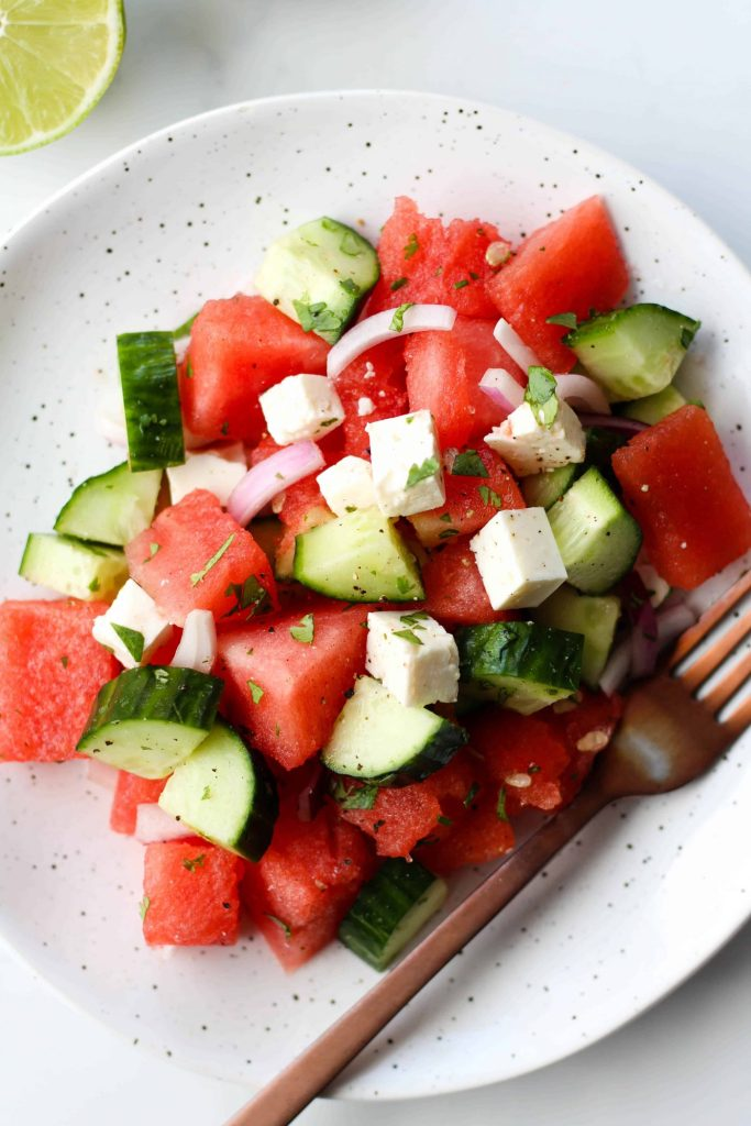 Refreshing Watermelon Feta Salad with cucumber, red onion, cilantro and lime juice.