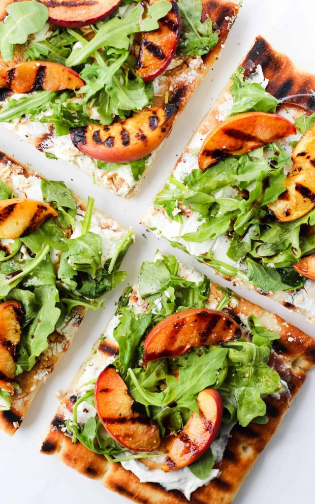 This grilled peach and arugula flatbread pizza with goat cheese and balsamic is an easy and delicious summer meal.
