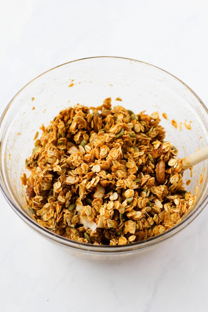 Mixing pumpkin granola ingredients
