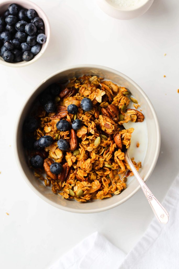 This healthy recipe for Maple Pumpkin Granola easy to make, vegan and gluten-free. It's crunchy, clustery and loaded with good stuff like pecans, pumpkin seeds and coconut chips.