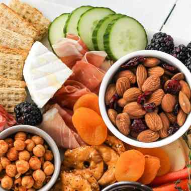 A snack board contains a variety of finger-foods and snack options like meats, cheeses and fruit. Learn how to make a healthy, Instagram-worthy snack board that will have friends and family drooling.