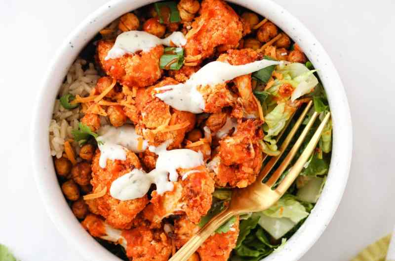These Buffalo Cauliflower Bowls are loaded with buffalo cauliflower, smoky roasted chickpeas, crisp lettuce, and of course: ranch! A simple, nourishing meal for any day of the week!