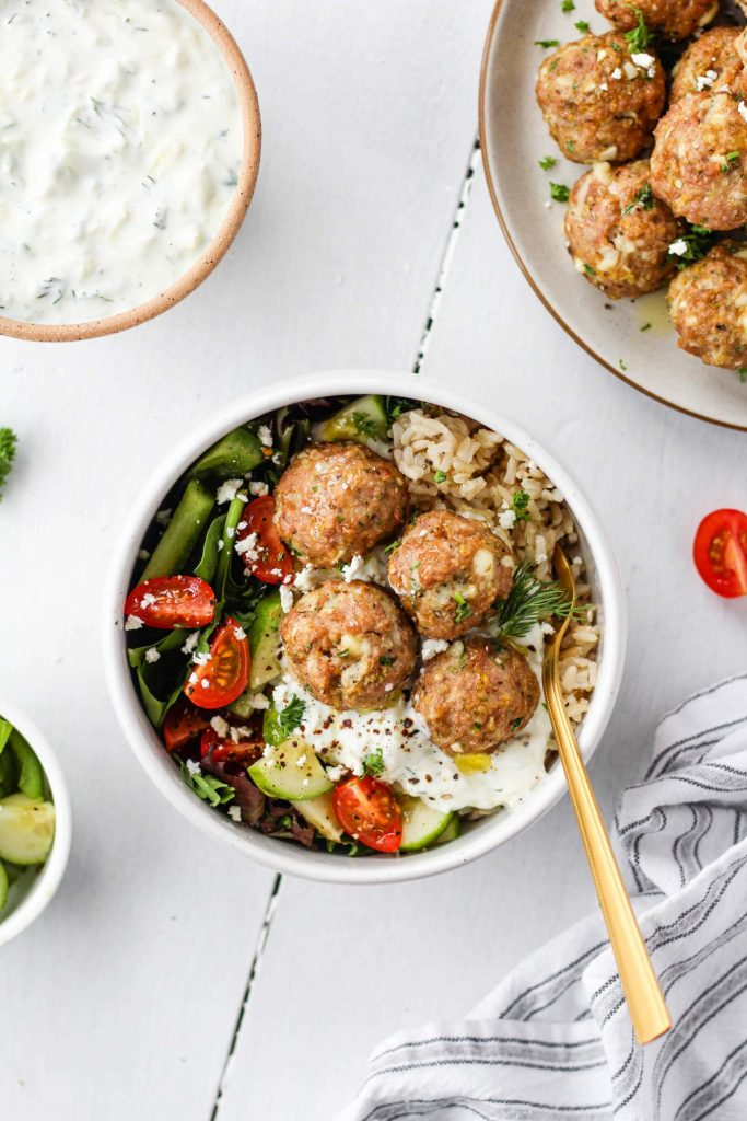 Flavourful and juicy Greek Chicken Meatballs with homemade Tzatziki. They make a delicious lunch or healthy dinner!