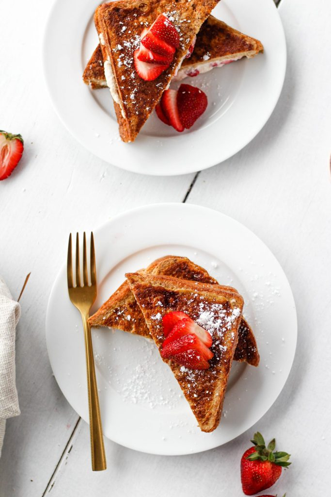 Say hello to your new favourite brunch recipe for spring! This Strawberry Stuffed French Toast looks fancy, but it's easy to make! As far as French toast goes provides a healthy balance of fibre-rich carbs and protein to keep you full and satisfied.