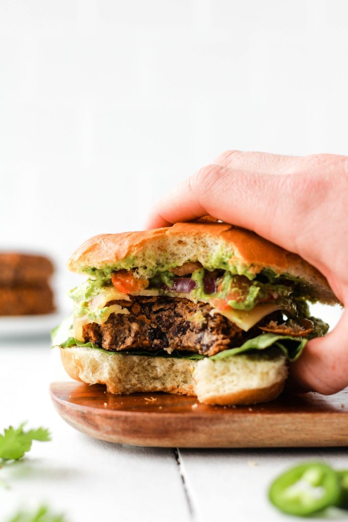 This spicy bean burger is nutritious, delicious, and easy to make. Paired with homemade cilantro avocado sauce, this might just be the most flavourful vegetarian burger ever!