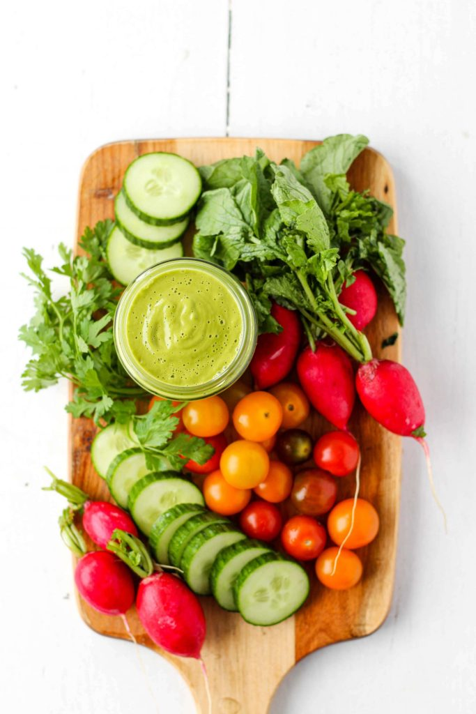 A healthy, creamy and delicious Avocado Green Goddess Dressing to elevate all of your veggies! Serve as a vibrant salad dressing or as a dip for vegetables, crackers and more. This recipe is naturally vegetarian and gluten-free, and can easily be made vegan.