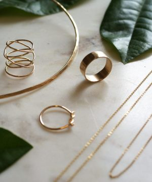 Gold Rings and Necklaces on Marble