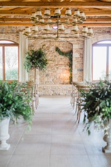 Wedding ceremony set up in natural colors and stony textures in Pyrgos Petreza Athens.