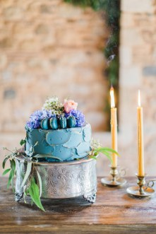Wedding cake styled by photographer and captured against natural stone background using ambient lighting.