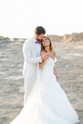 Professional Crete wedding photoshoot, bride and groom posing for the wedding photographer at the beach in Chania Crete.
