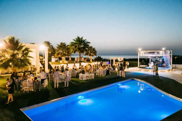 General view over the wedding estate floor plan and decoration set up on a wedding day in Ktima Reveli in Chania Crete photographer by wedding photographer from a higher vintage point.