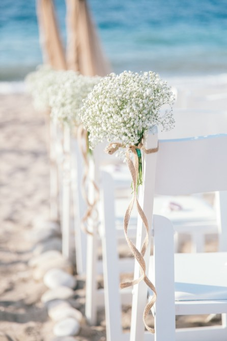 Beach ceremony set up in natural tones and fabrics for a symbolic ceremony planned and coordinated by a local wedding planner and photographed professionally.