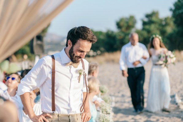 Portrait of the groom awaiting the bride under the wedding canopy on the beach.