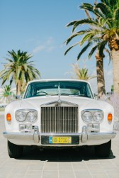 Rolls royce bridal car parked in front of Caramel luxury hotel awaiting the bride to come out to drive her to the wedding ceremony.