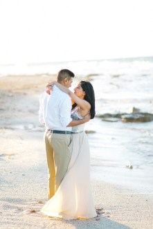 Engaged couple posing on the beach in Crete during their pre wedding engagement photosession at sunset.