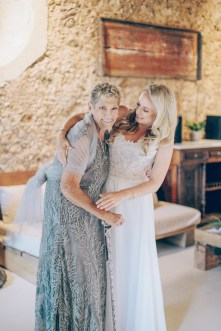 Beautiful bride with her mother posing for the wedding photographer on a summer wedding day in Chania, Crete.