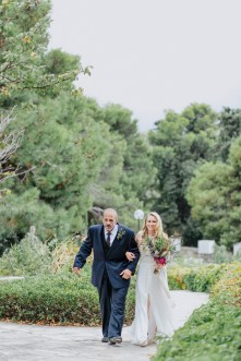 Bride being led by her father to the altar in Profitis Ilias, Chania, Crete.