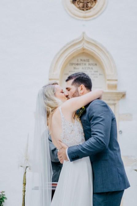 Beautiful bride and groom posing for wedding day portraits in Profitis Ilias, Crete island, Greece.