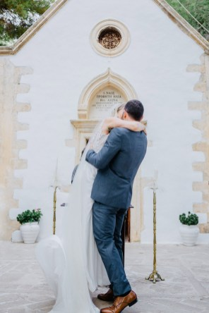 Beautiful bride and groom posing for wedding day portraits in Profitis Ilias, Crete island, Greece.