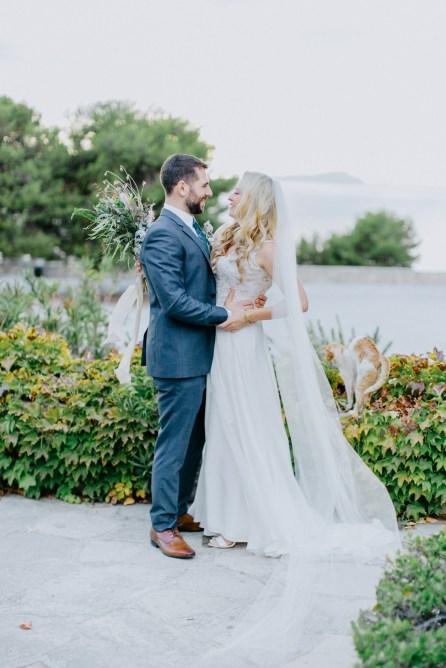 Beautiful bride and groom posing for destination wedding day portraits in Profitis Ilias, Crete island, Greece.