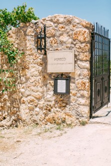 Rustic Agreco farm by Grecotel photographed on a sunny wedding day in Crete.