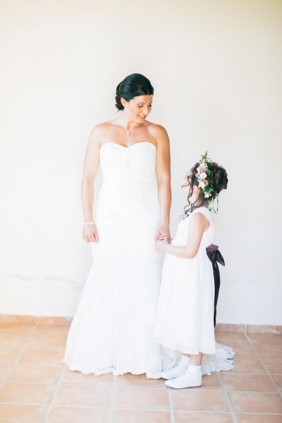 Elegant bride posing for her fine art portraits on a wedding day in Agreco Farm in Crete.