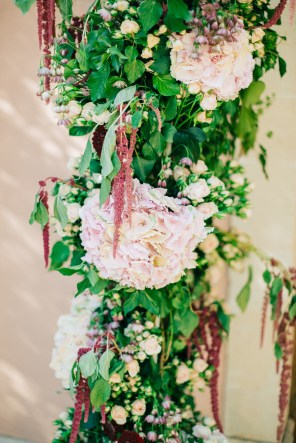 Rich floral decorations and details created by Fabio Zardi and captured by wedding photographer during a destination wedding in Agreco farm in Crete.