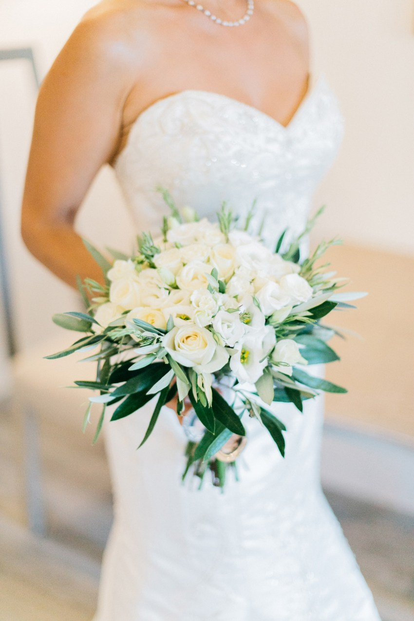 Professional portrait of a beautiful happy bride on her wedding day in Crete.