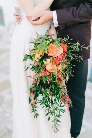 Wedding flowers held by a bride on the wedding day in Mykonos.