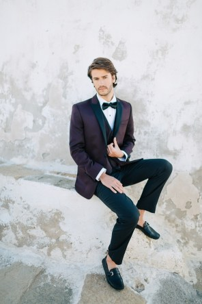 Stylish modern groom at his wedding in Mykonos island, Greece.