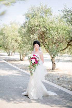 Beautiful modern bride posing for wedding photographer on her wedding day.