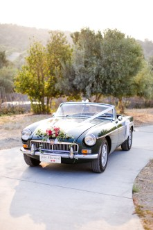 Just Married - decorated vintage wedding car.