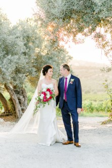Elegant newlywed couple posing for portraits on their wedding day in Crete.