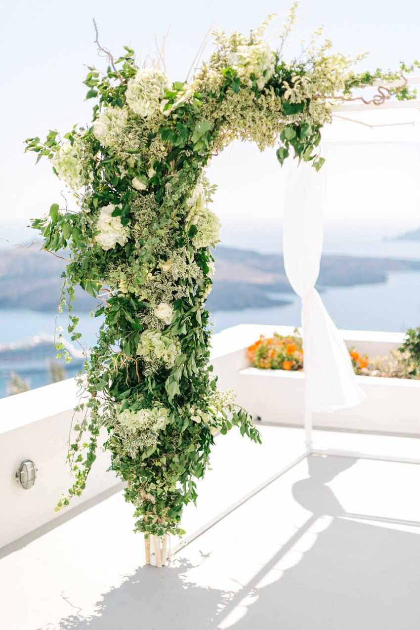 Wedding ceremony setup in Santorini caldera.