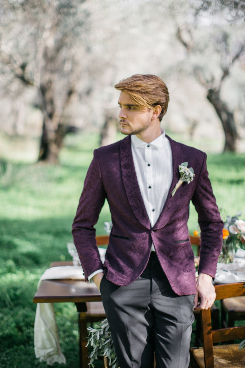 Groom wearing fancy suit and styled for wedding in Crete
