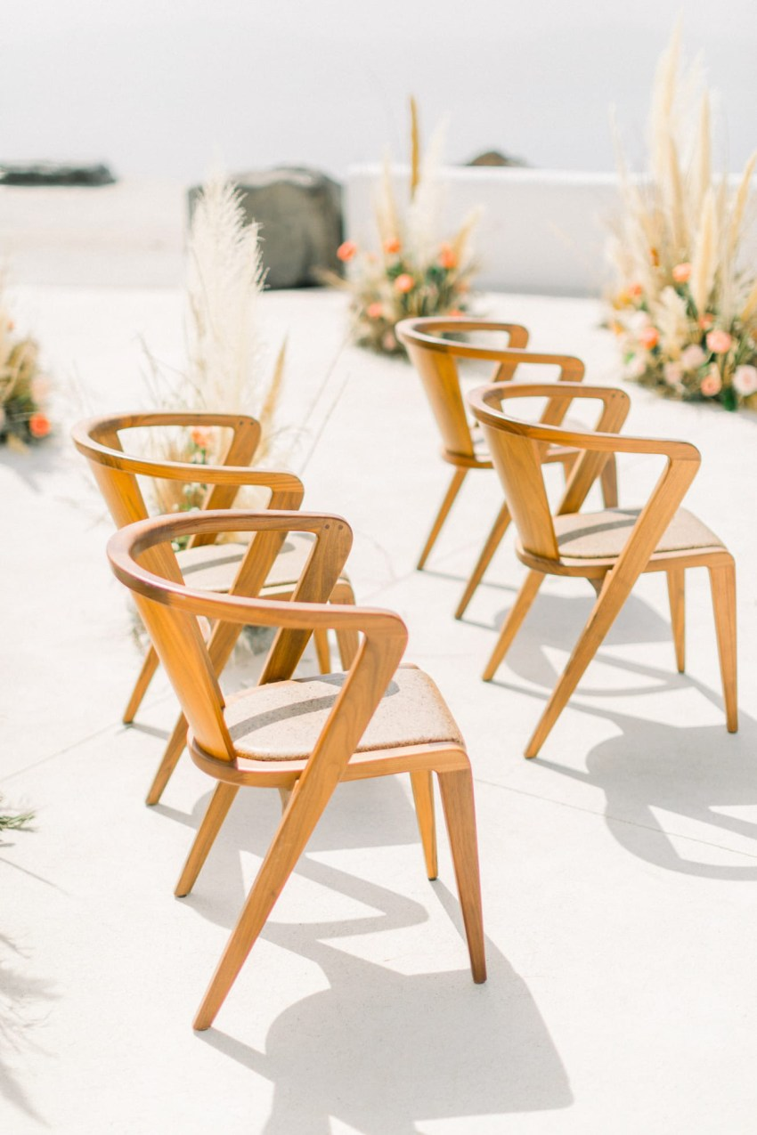 Luxury vintage chairs for wedding ceremony setup in Santorini.