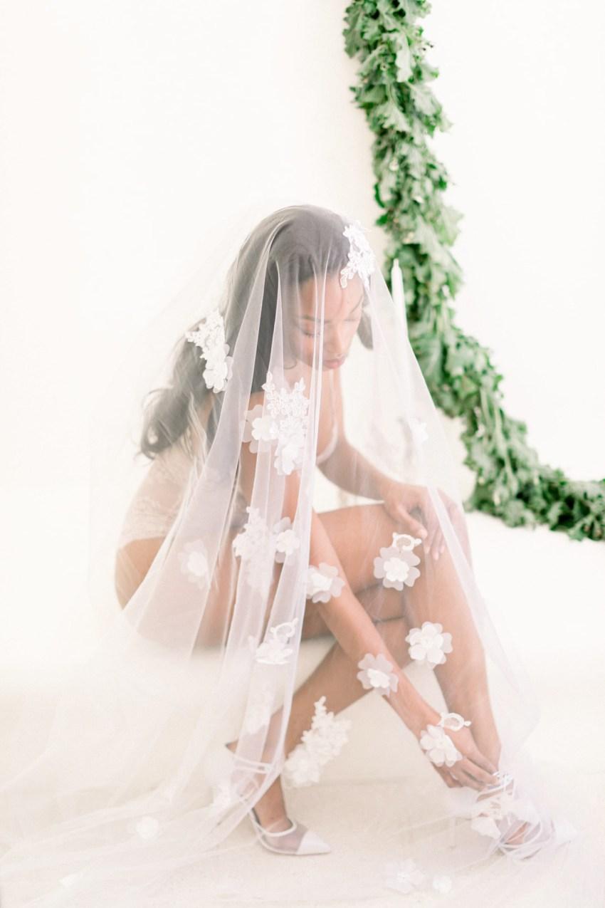 Beautiful black bride at a white villa wedding inspiration session in Loyal Villas Luxury, Mykonos, Greece.