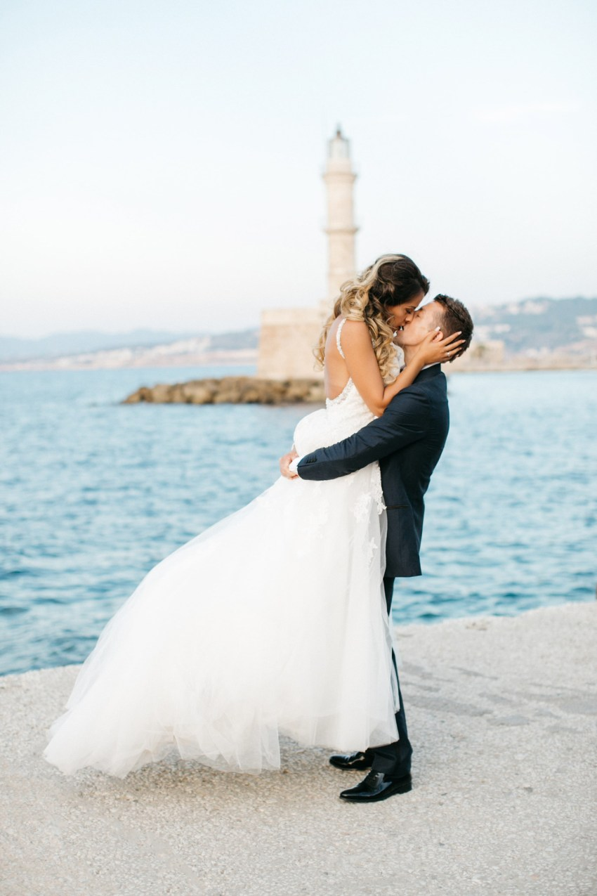 Elegant international couple on their destination wedding day in Chania Crete Greece.