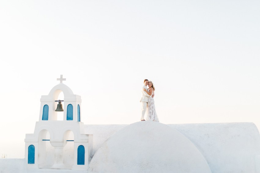 Newlyweds in Oia on their wedding day in Canaves Suites Oia Santorini.