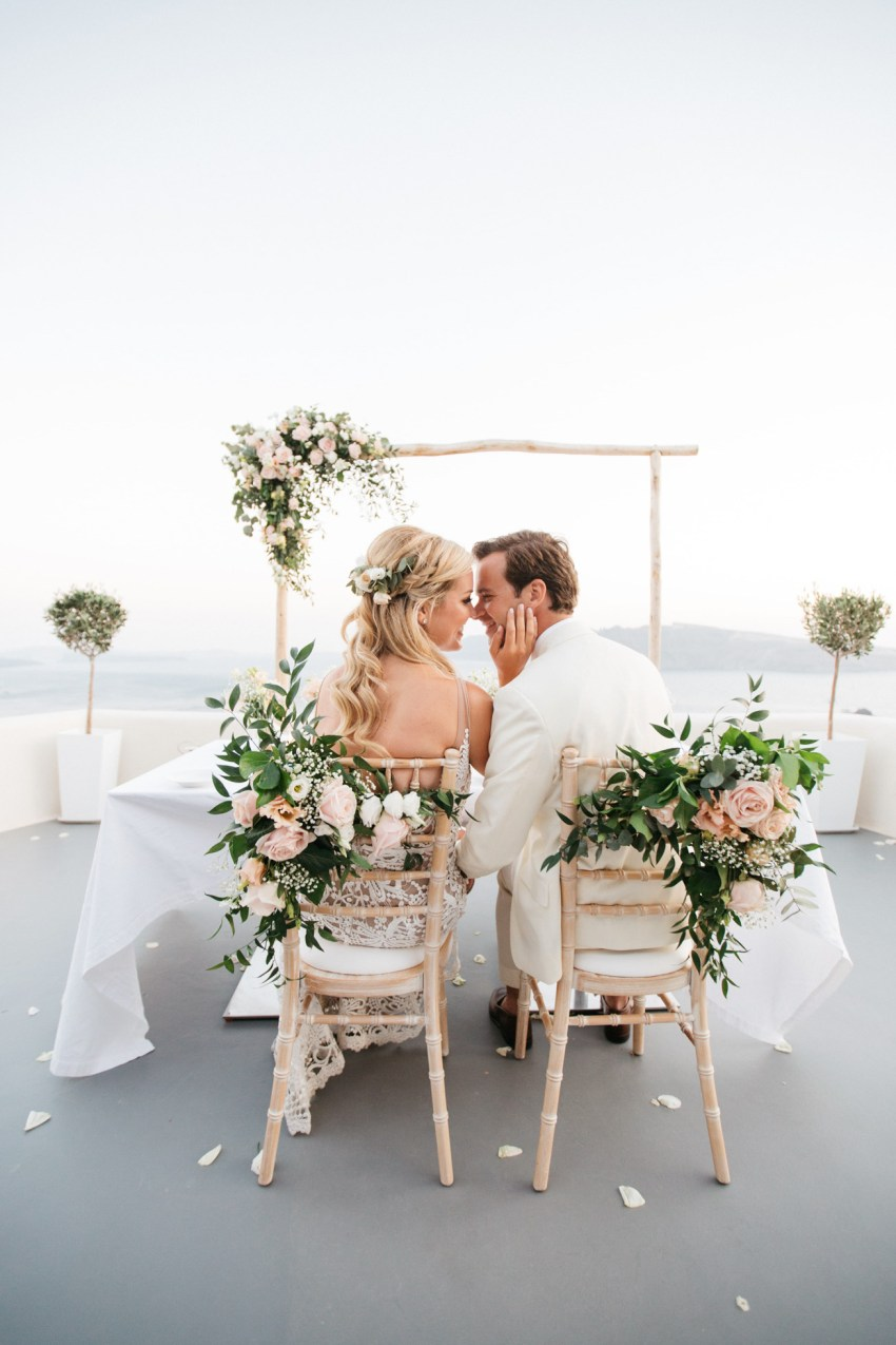 Beautiful newlywed couple celebrating their wedding in Canaves Suites Oia Santorini.
