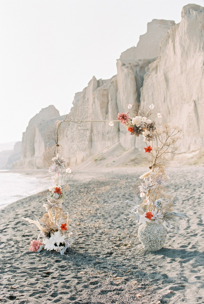 Unique ocean-inspired wedding canopy and ceremony setup at a beach wedding inspiration shoot in Santorini Greece.