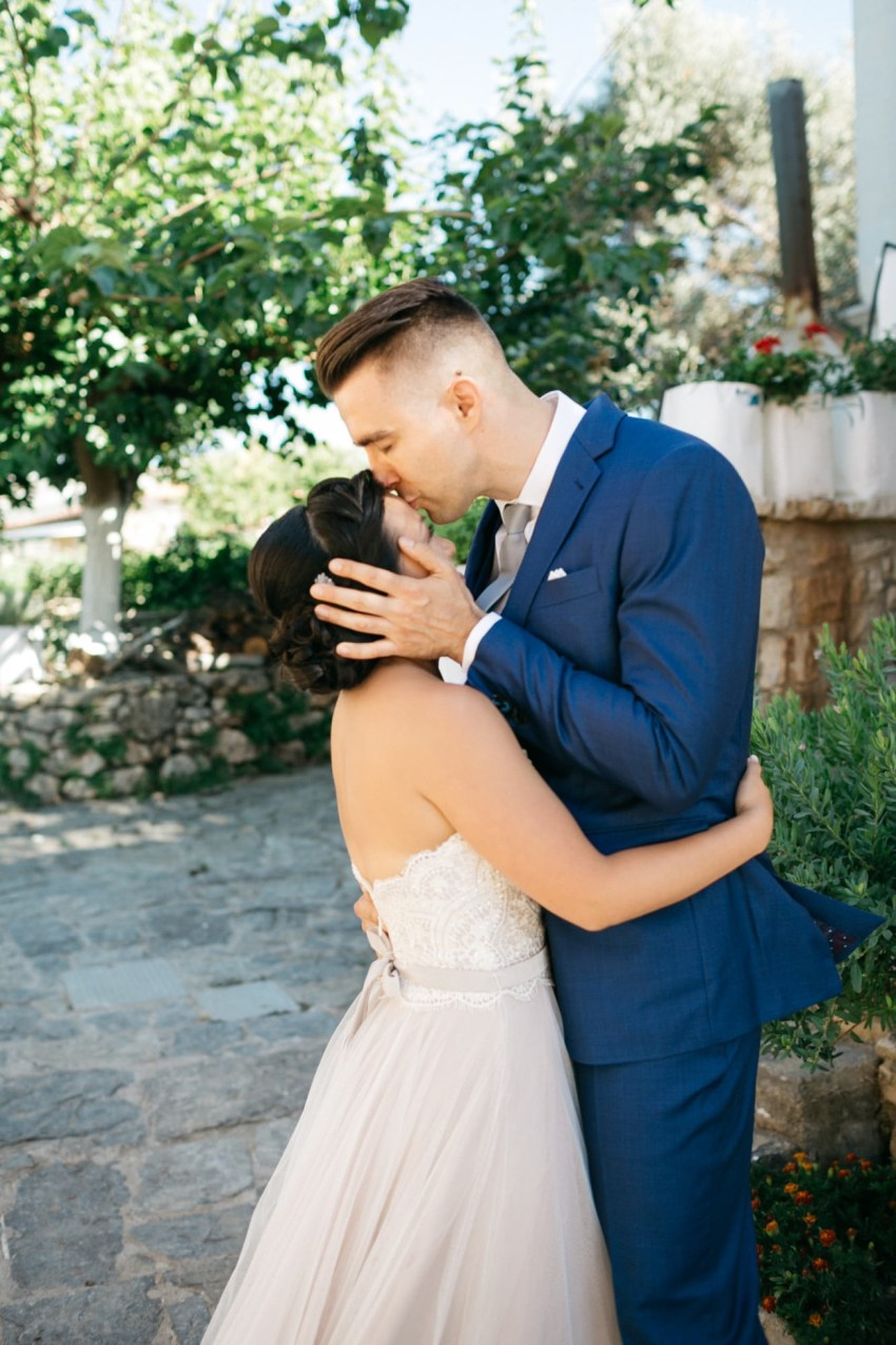 First look of the bride and groom in Agreco Farms, Grecotel, Crete, Greece.