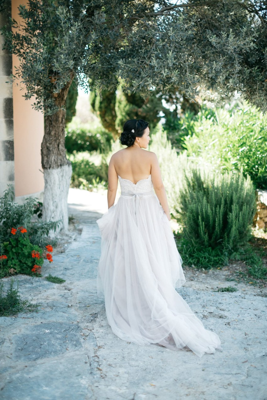 Elegant bride in Agreco Farms, Grecotel, Crete, Greece.