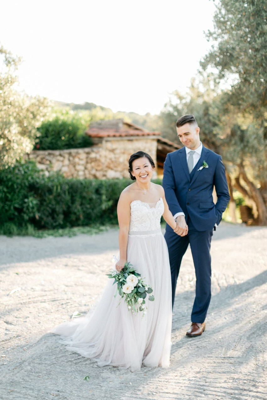 Bride and groom at their vineyard destination wedding in Agreco Farms, Grecotel, Crete, Greece.