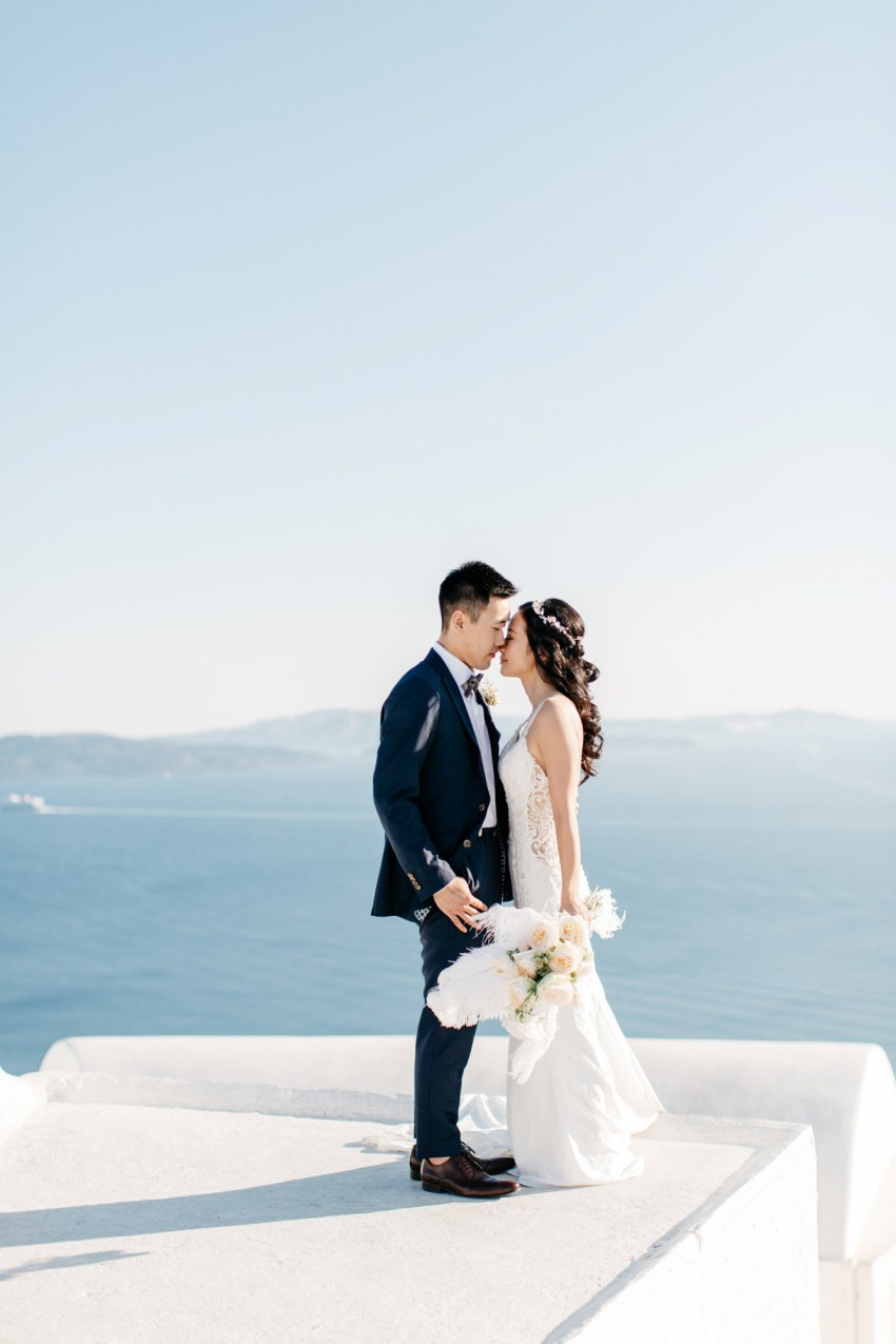 Classy destination wedding in Aenaon Villas in Oia Santorini Greece.
