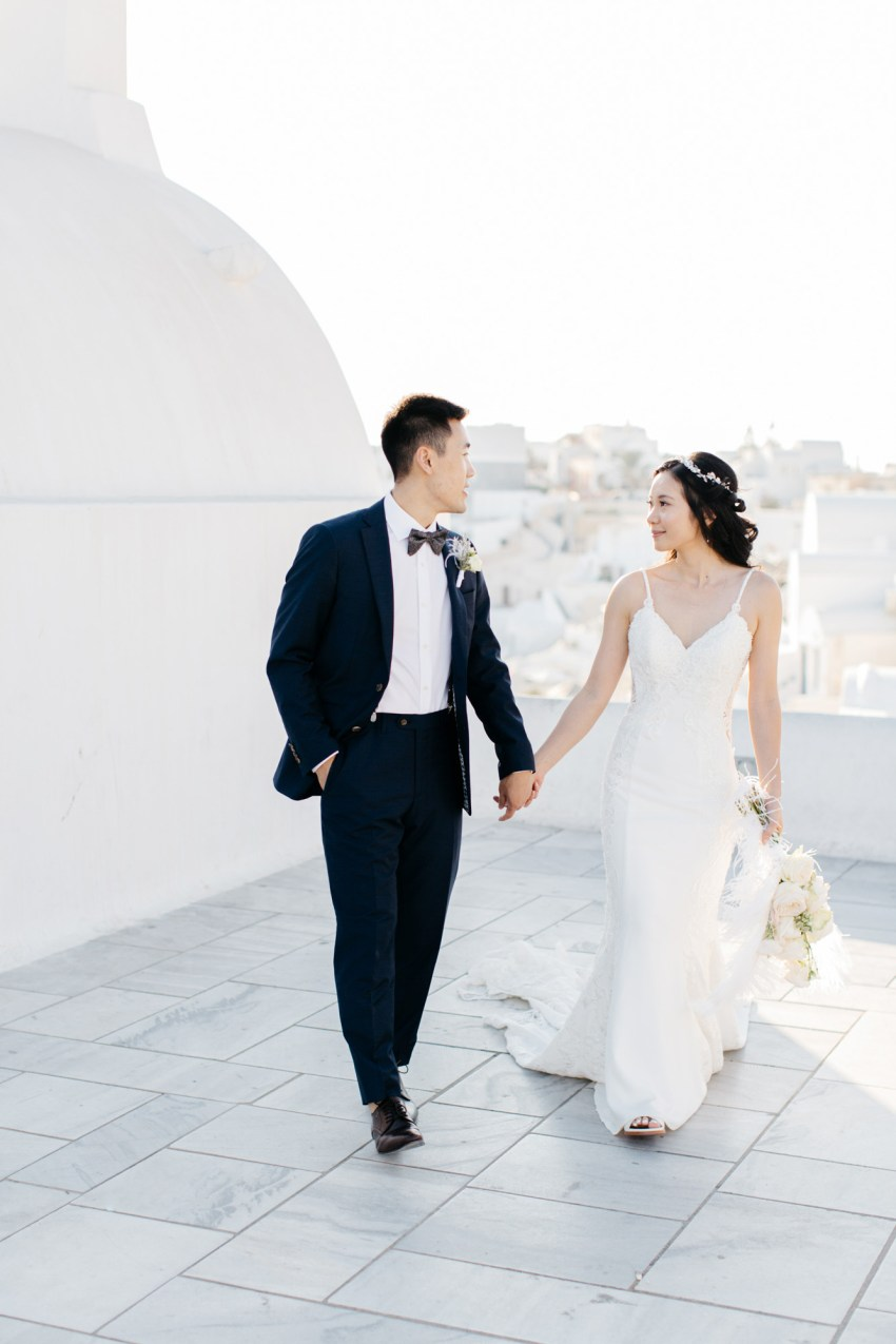 Classy destination wedding in Aenaon Villas in Oia Santorini Greece.