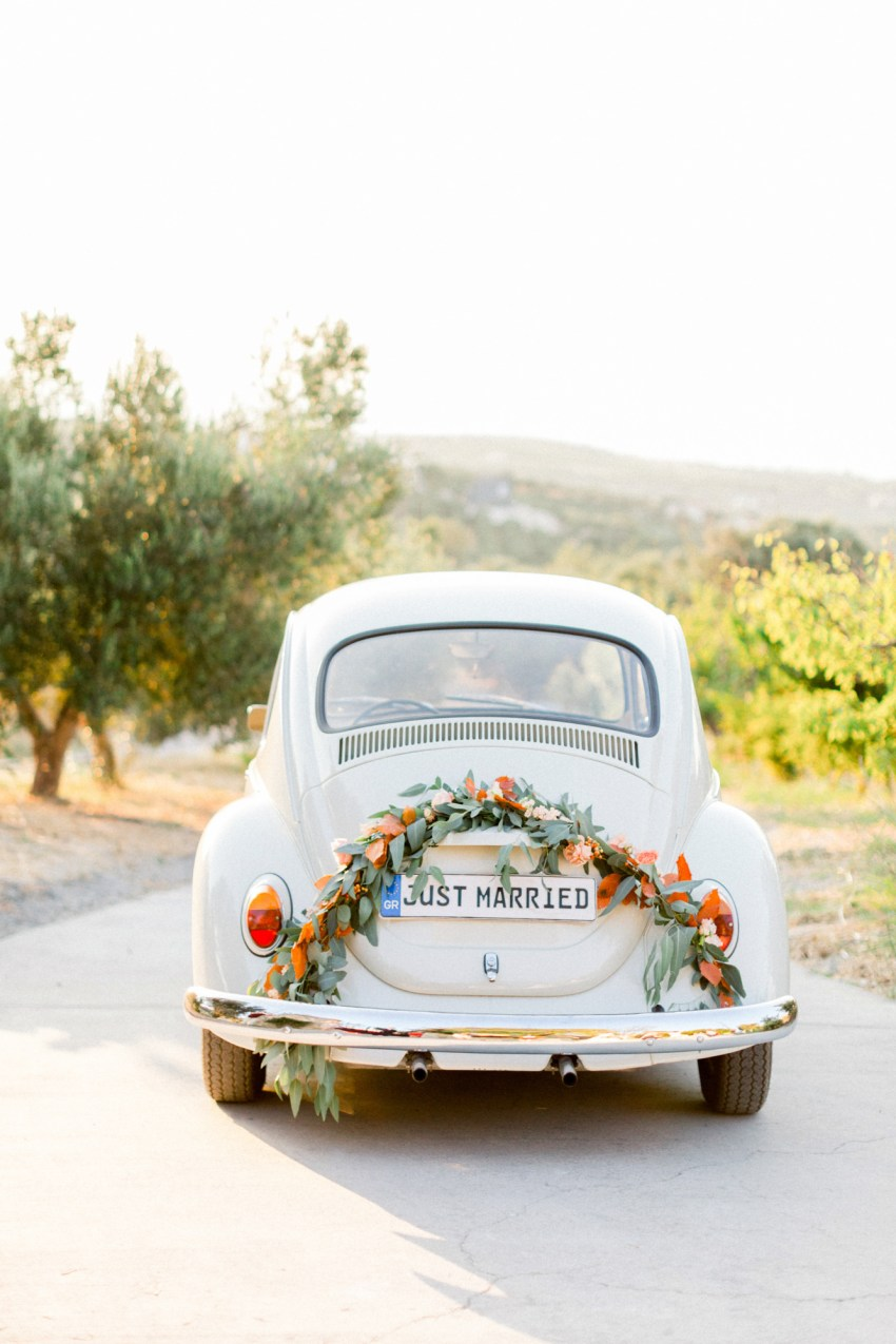 Vintage getaway car for a sunset wedding editorial in Grecotel Agreco Farms Crete Greece as published on Ruffled blog.