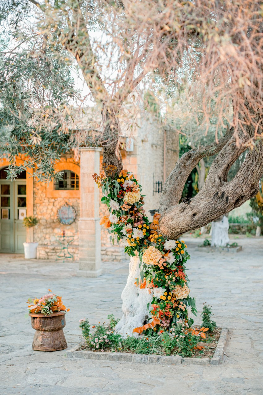 Reception decoration, flowers and details by R&C events and Oneiranthi for a sunset wedding editorial in Grecotel Agreco Farms Crete Greece.