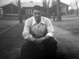David D. Hanneman poses on the carriage stone, circa 1947.