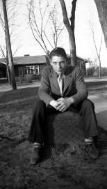 David D. Hanneman poses on the carriage stone, circa 1946.